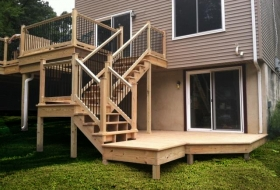 Wood deck with metal railings.