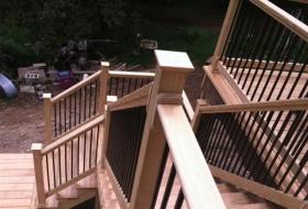 Wood deck with metal railings.