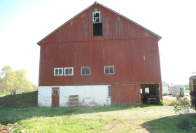Front end of the barn after new metal siding is installed
