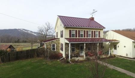 House with new standing seam Price range: $13,500 - $15,600