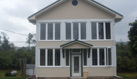 House with new 2 story enclosed porch. Price range: $27,000 - $32,100
