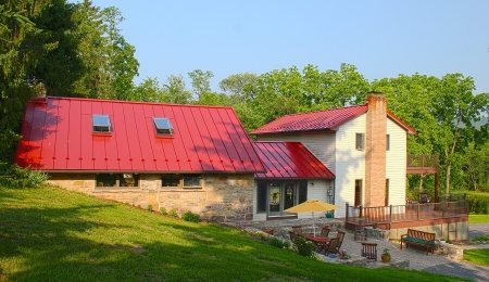 New standing seam roof and vinyl deck