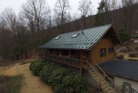 Standing roof on a log Home. Price range: $12,700 - $14,300