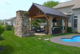 Timberframe Pavilion With a Standing Seam Roof Price Range: $9600 - $11,200