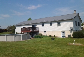 Slate Standard Metal Roof Price range: $6700 - $8700