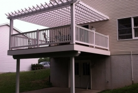 Pergola over a Vinyl deck. Price range: $8900 - $9700