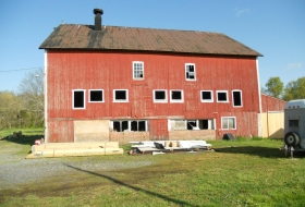 Front side of the barn before restoration and new metal siding