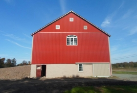 Front end of the barn before restoration and new metal siding